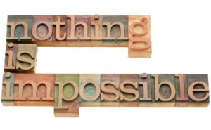 9669346 - nothing is impossible - motivation concept - isolated text in vintage wood letterpress printing blocks